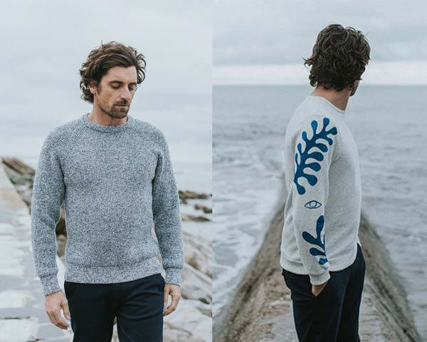 Man wearing grey marl sustainable knitwear and man wearing seaweed print organic cotton long sleeve t-shirt from sustainable fashion brand Bask In The Sun