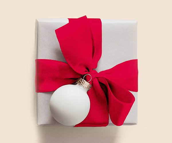 present with red bow and white ornament