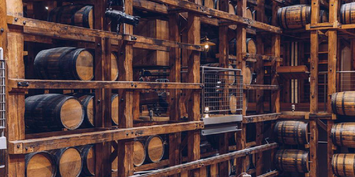 Inside storing unit for wine barrels highlighting the importance of storing in a cool dark place.