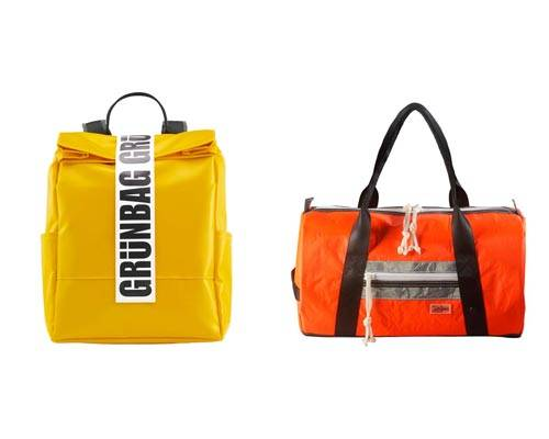 yellow recycled tarpaulin rucksack with black handles and large grunbag closure branding and orange sports holdall with black handles