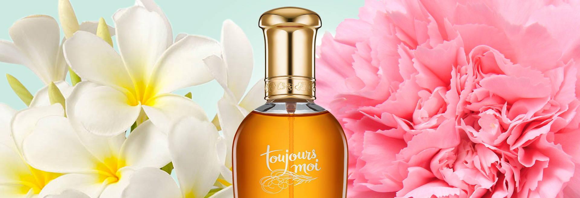 Bottle of Toujours Moi cologne, flowers