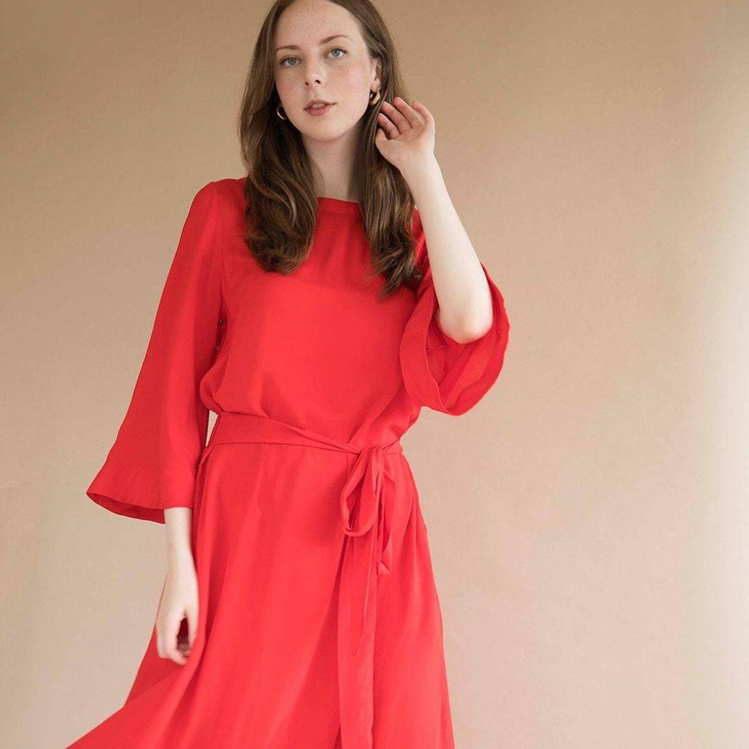 tomoko bell sleeve midi dress in red on model