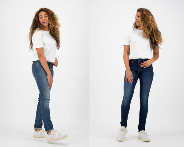Woman wearing mid wash organic cotton sustainable jeans from Kuyichi