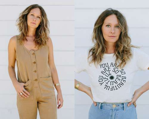 "Woman wearing hemp button up dungarees in taupe and woman wearing organic cotton t-shirt with text in a spiral saying ""you are so beautiful"" with light blue denim bottoms from sustainable brand Jungmaven"
