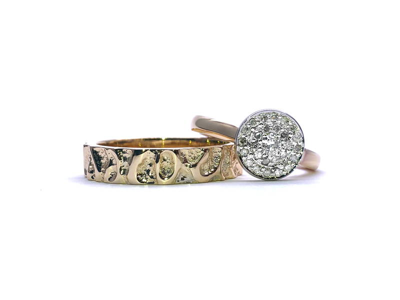 textured men's ring duo and women's ring halo diamond