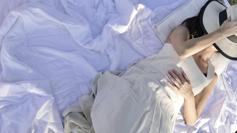 Girl laying on Weavve's Lyocell Duvet
