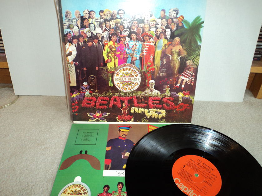 The Beatles - Sgt. Peppers Lonely Hearts Club Band  - 1976 Capitol SMAS 2653 Orange Label Mint w/ cutout