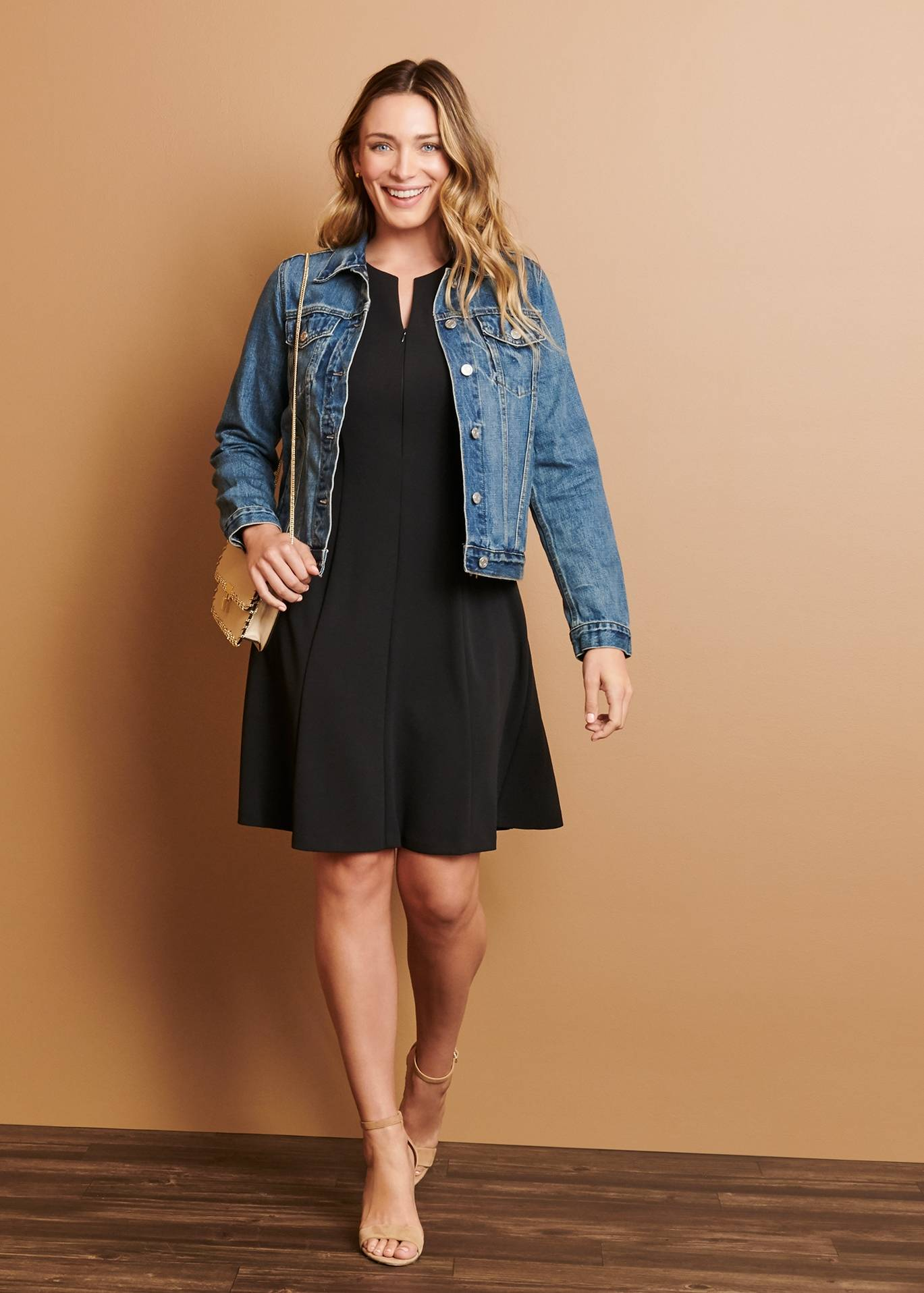 woman in black sleeveless casual dress and denim jacket on connected apparel day to night blog