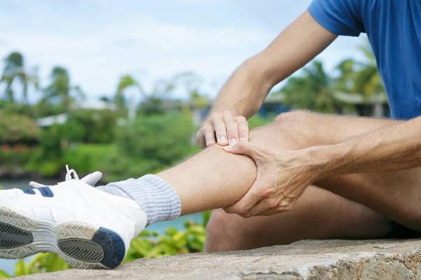 Man massaging sore calves