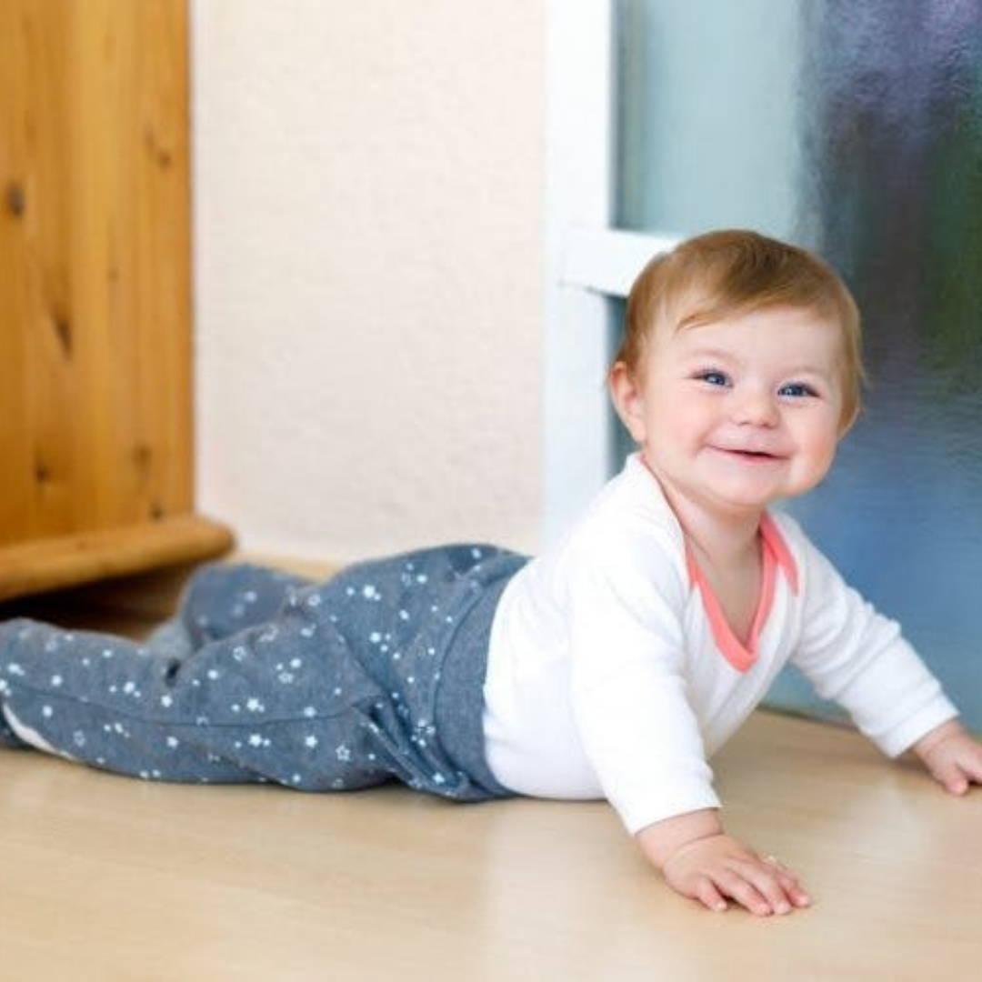 Happy baby commando crawling