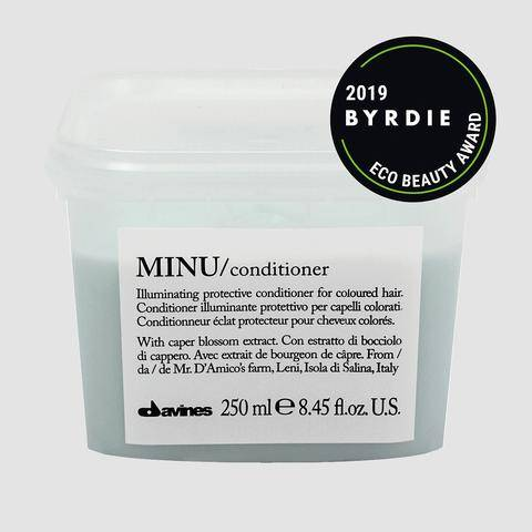 Davines MINU conditioner tub with Byrdie Beauty Eco Beauty Award sticker