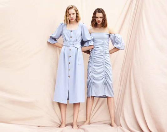 two women wears blue dress