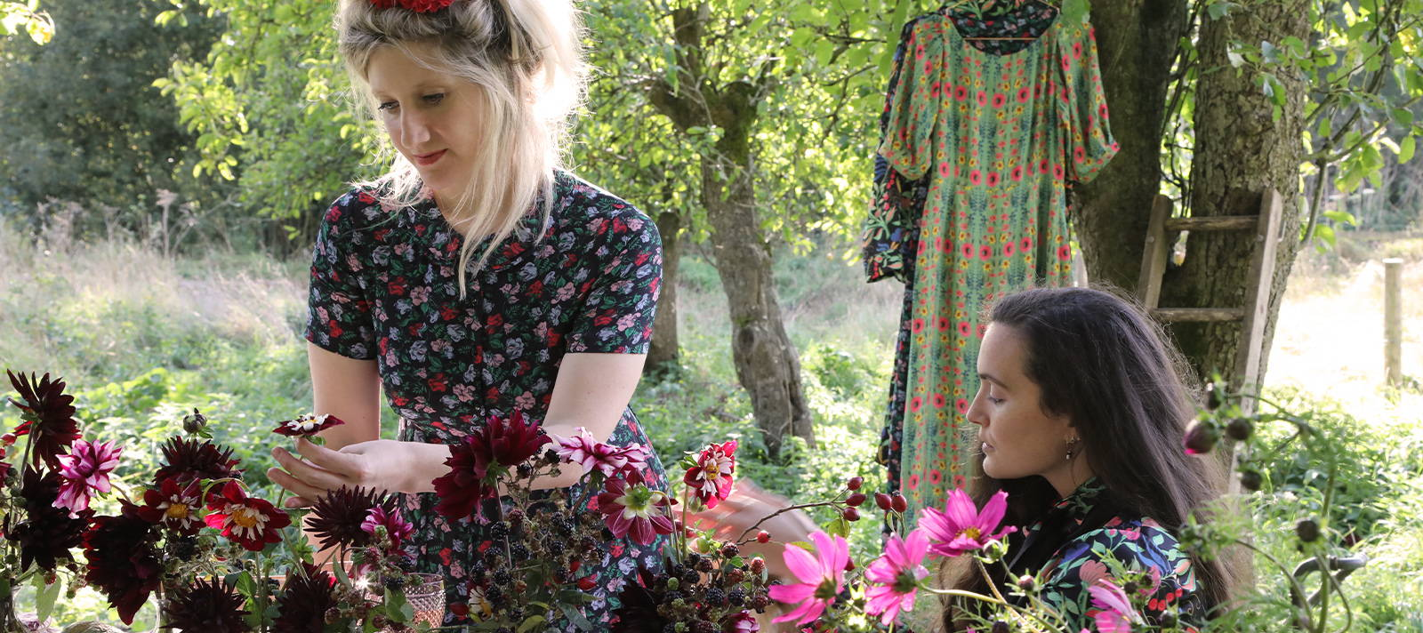 Kitten Grayson and Harriette Tebbutt wearing YOLKE and arranging flowers