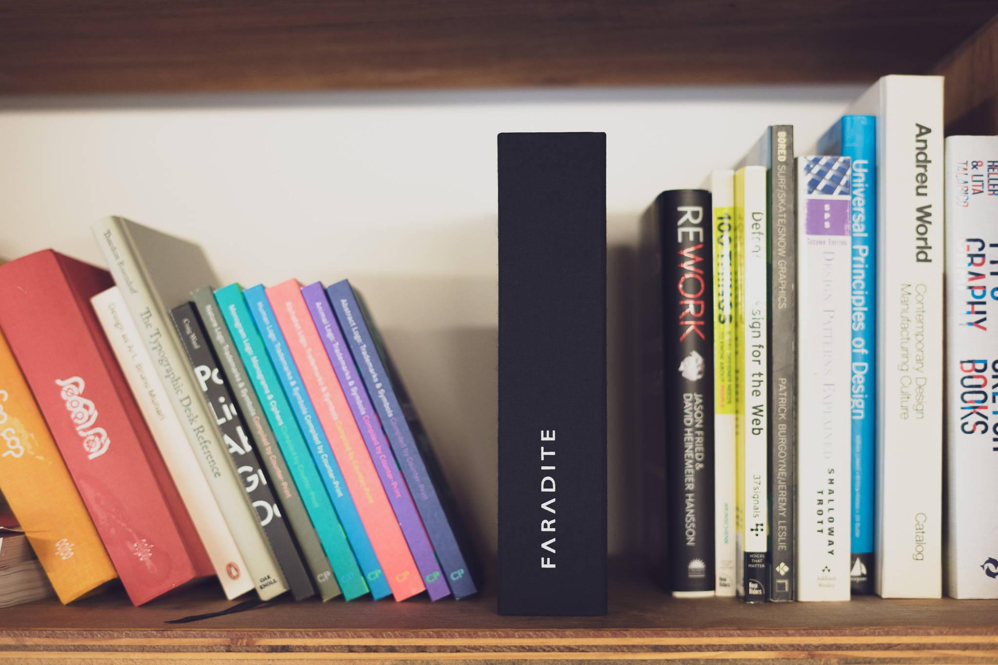 Faradite Sample Case folded on a bookcase
