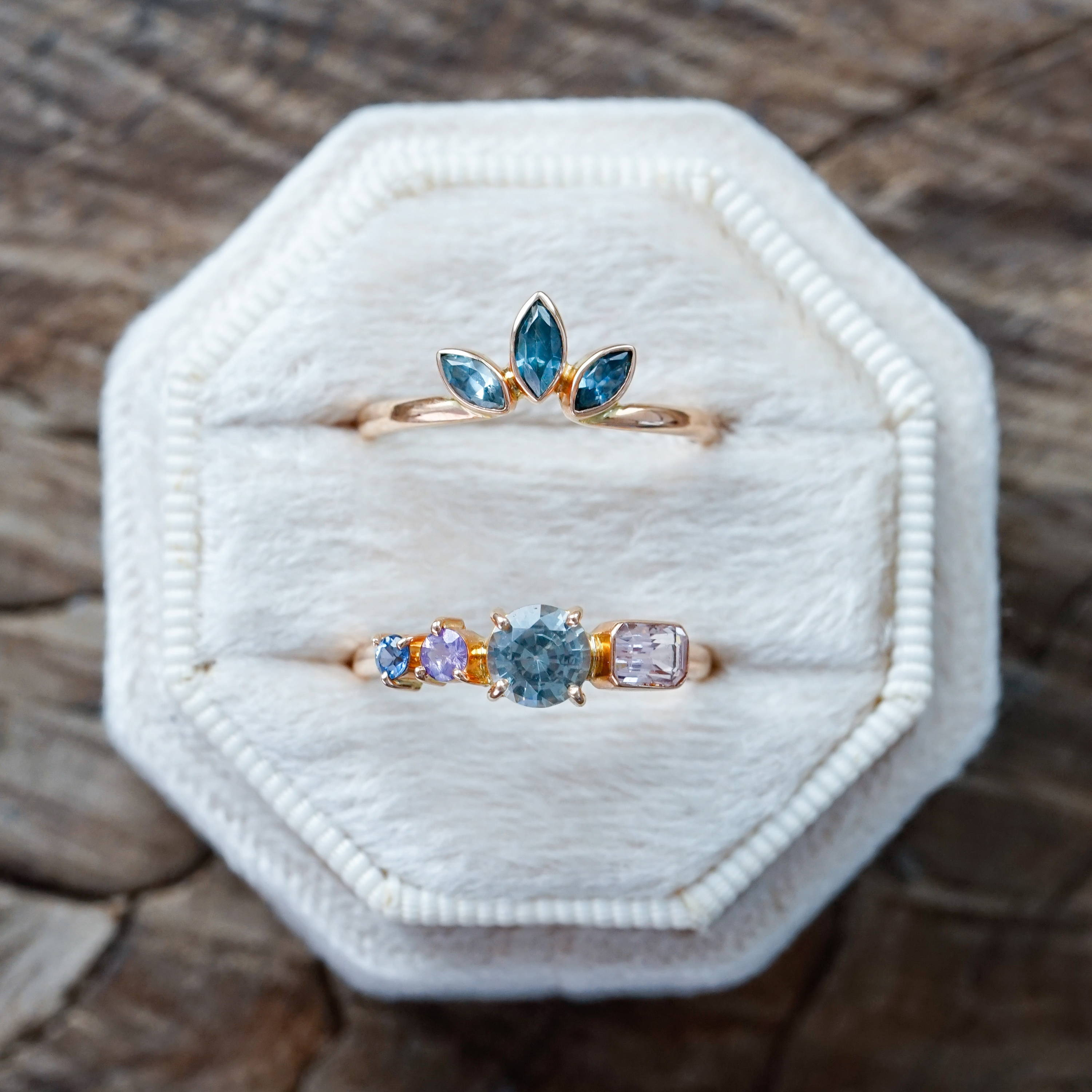 Pastel sapphires ethical gold ring set, perfect for a bridal set.