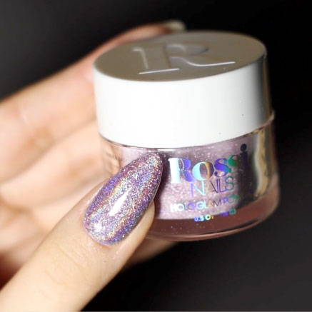 Liquid, Nail polish, Cosmetics, Purple, Finger, Violet, Material property, Body jewelry, Nail, Glitter
