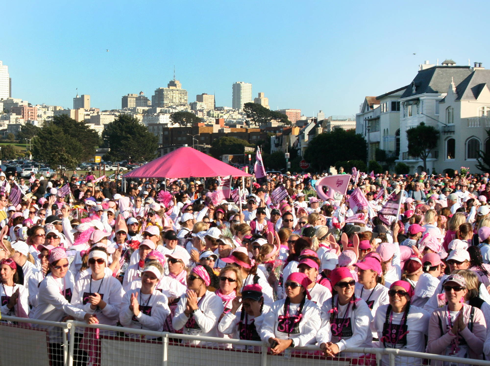 large crowd of supporters wearing pink at a breast cancer awareness event in streets of San Francisco