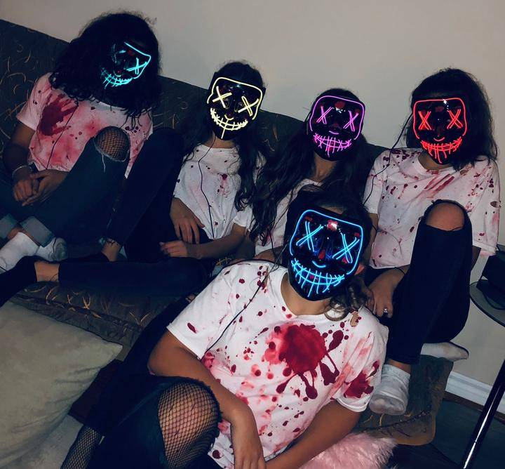 Girls wearing halloween mask on a party