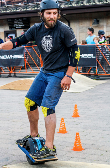 Kevin on the one wheel skateboard during the competition
