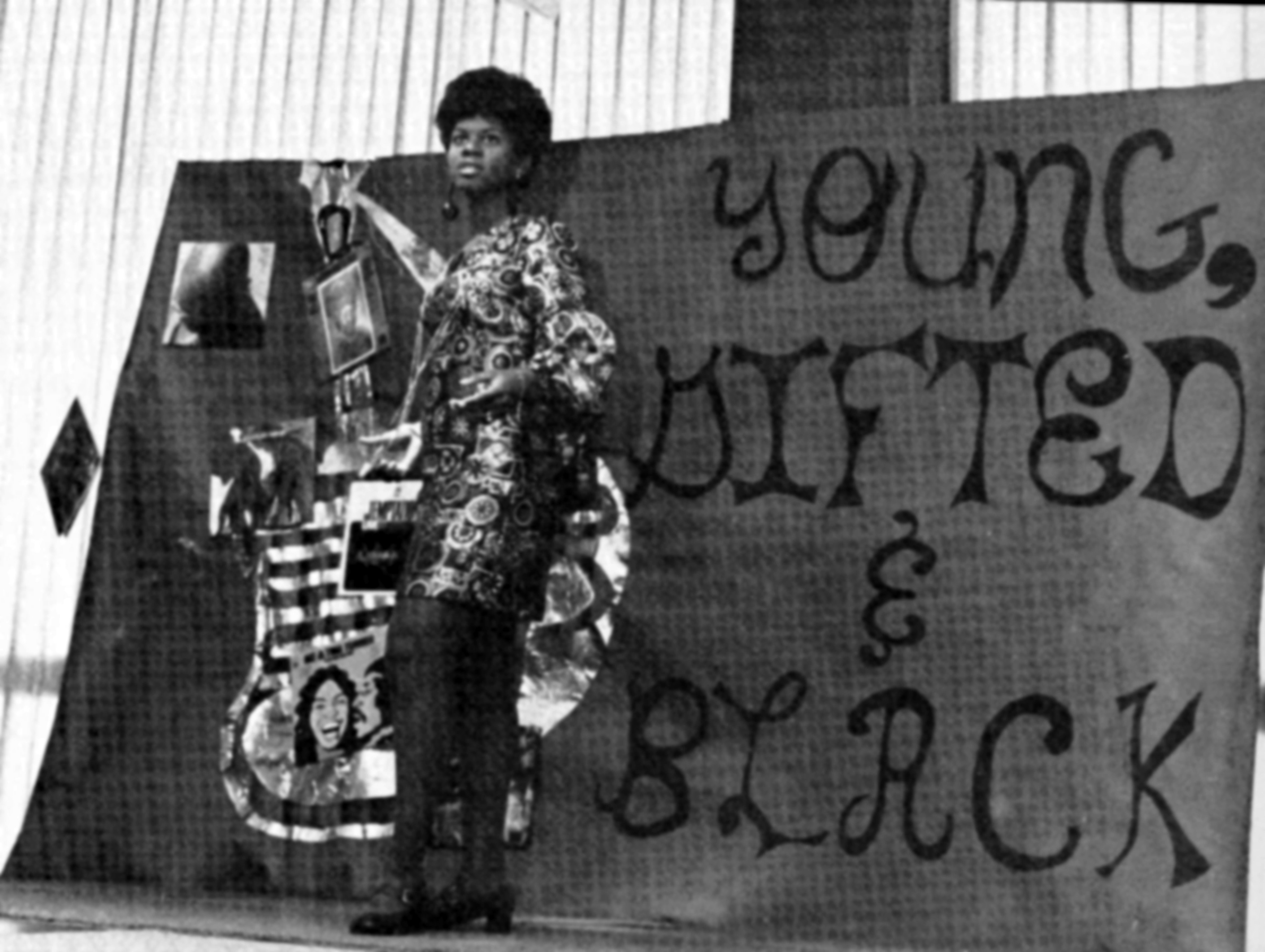 A young Nina Simone, against a poster that reads, young gifted and black, with a colorful dress.