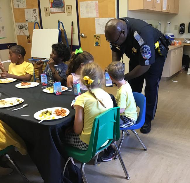 little girl serving police officer