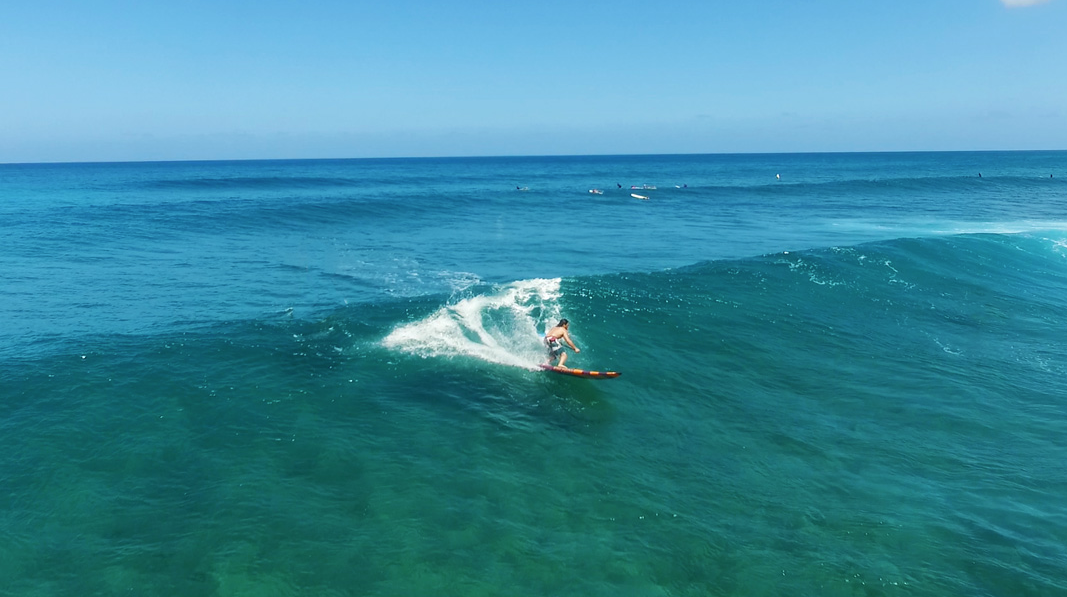 Todd surfing on his carve sup board by Pau Hana surf supply