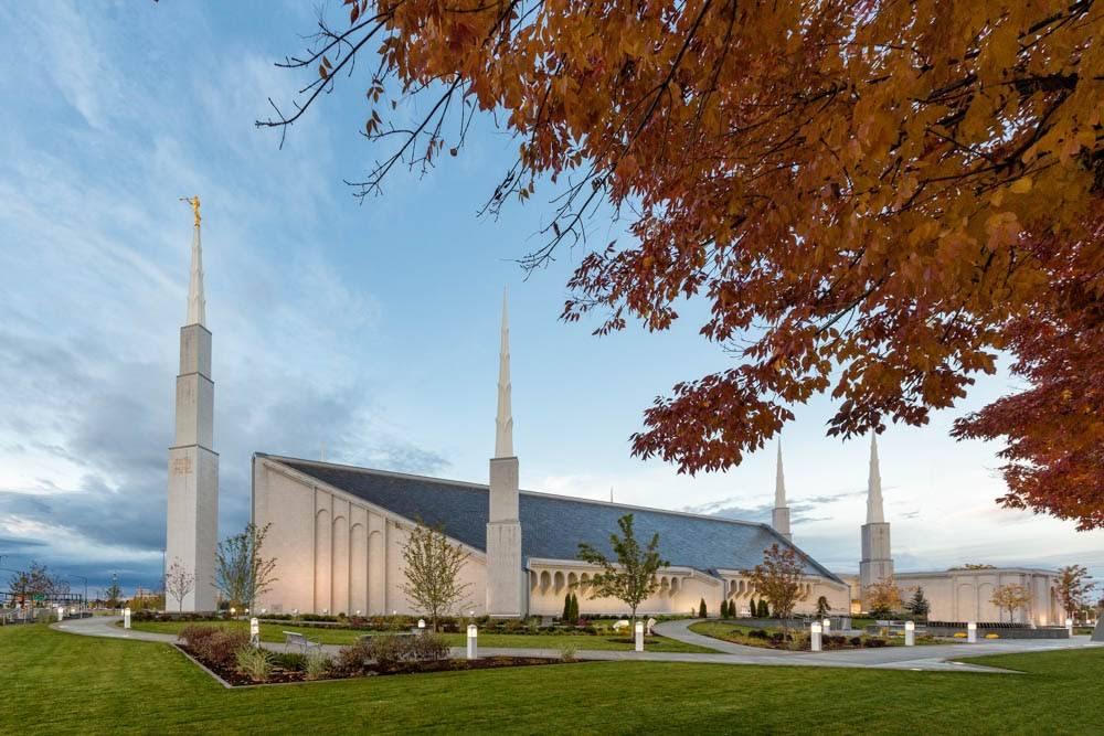 Boise Temple standing beneath autumn leaves.