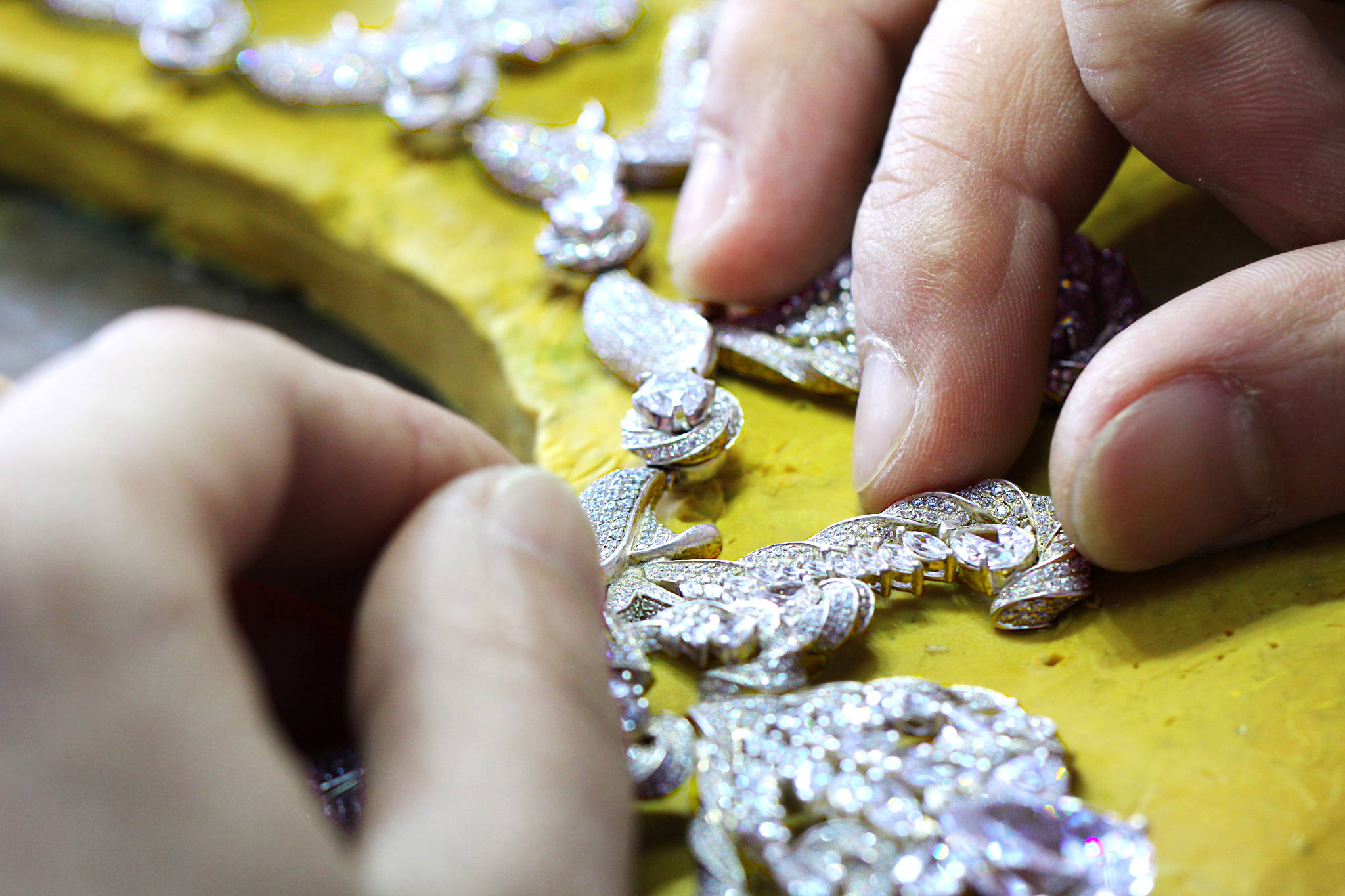 jewelry master attaching necklace pieces together yves lemay jewelry