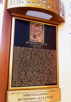 Image of the bust made for alfred Kinsey, his image is engraved and there is writing underneath it.