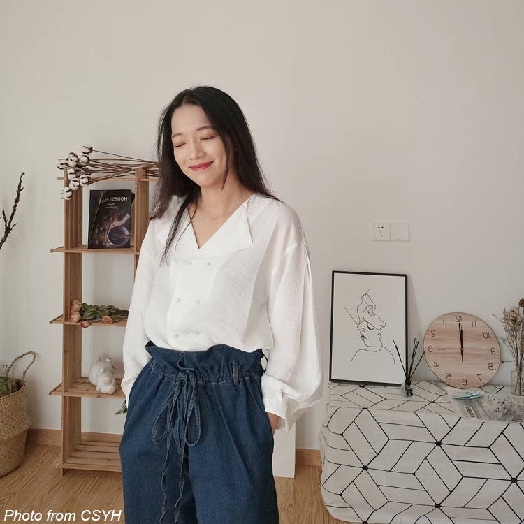 an asian girl is smiling while standing
