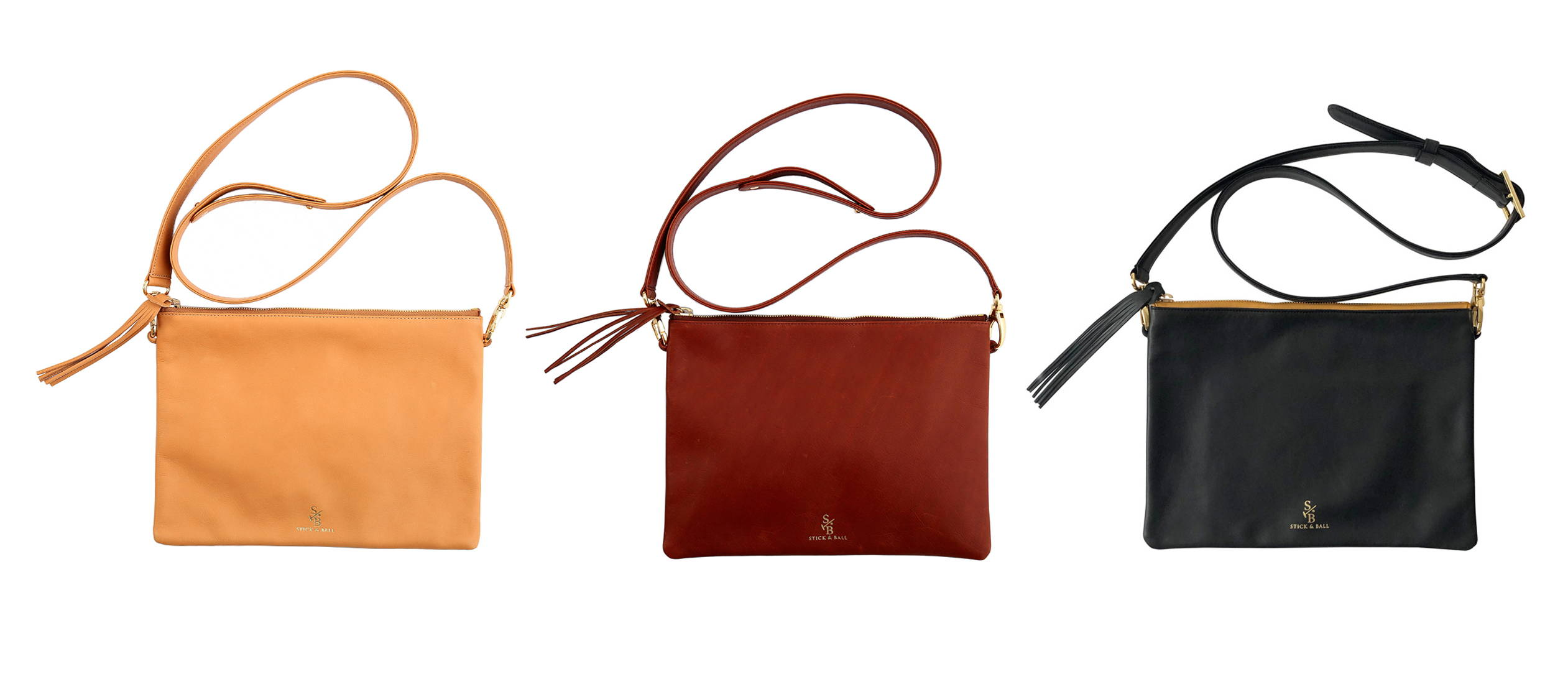 Display of vegetable-tanned Italian leather Indio crossbody bags/oversized clutch in palomino tan, brown & black - Stick & Ball