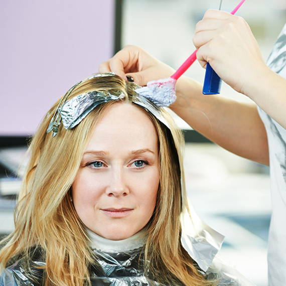 woman getting highlights