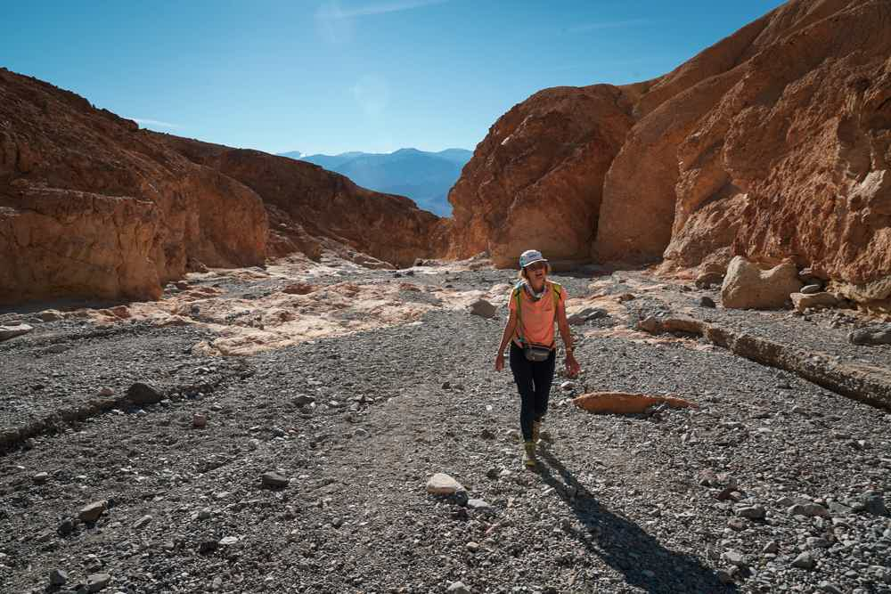Woman hiking in Gower Gulch in Golden Canyon in Death Valley National Park