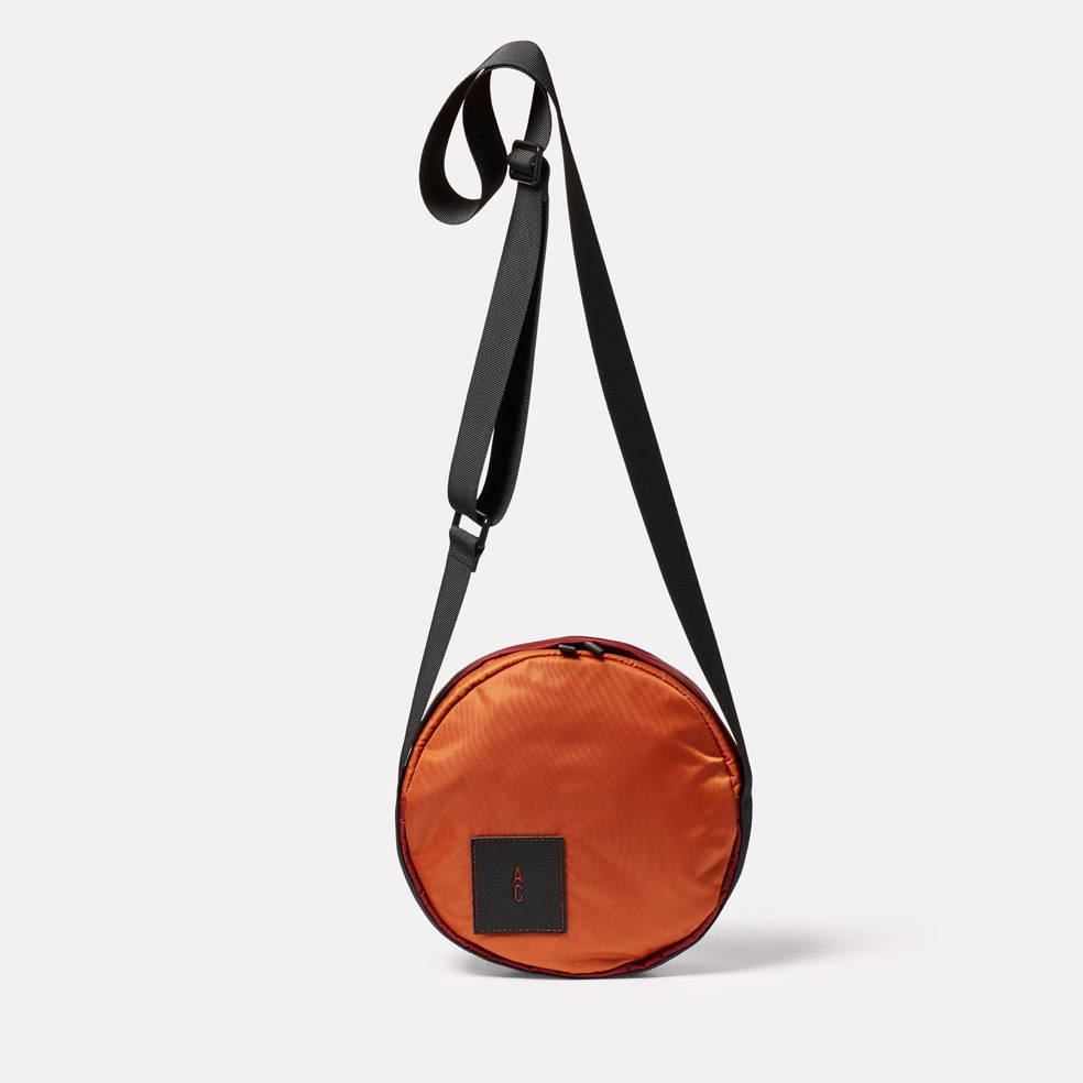 Bill Circle Nylon Crossbody Bag in Rust
