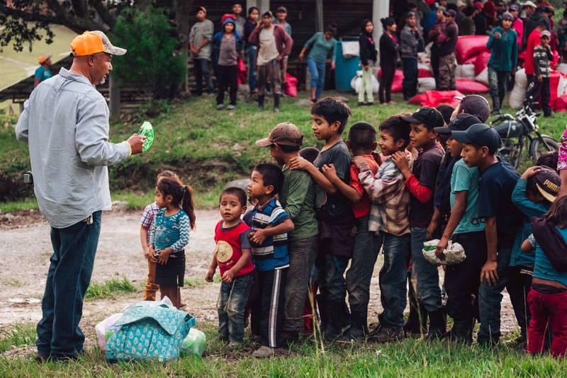 Our CEO, Al Lopez, helping children in Corquin.