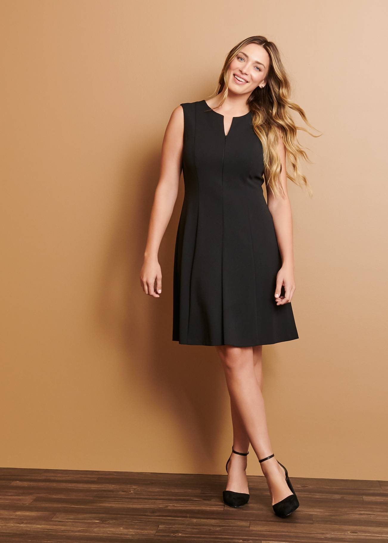 woman in black sleeveless cocktail dress on connected apparel day to night blog
