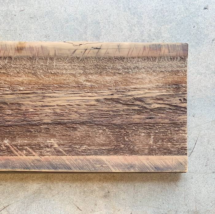 Close up of sanded reclaimed barn wood, brown