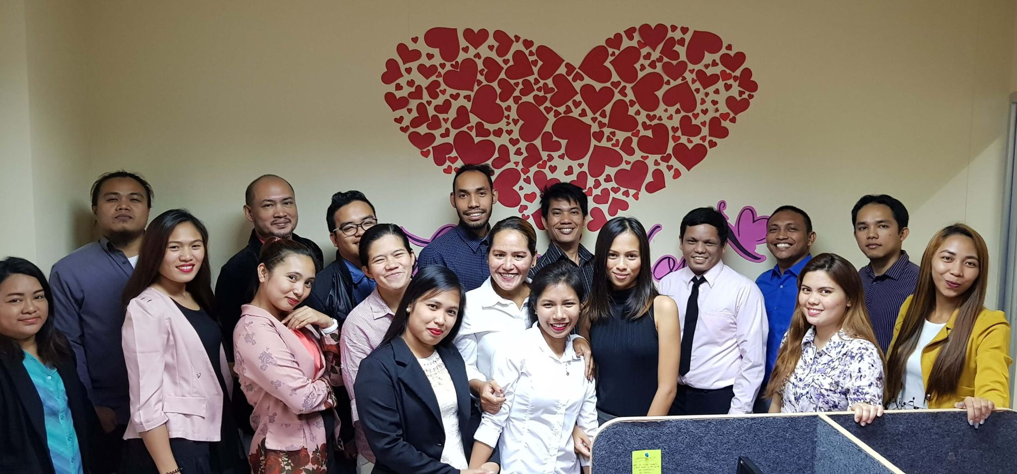 OBI Services About Us Group Pic with Heart Desktop View Image