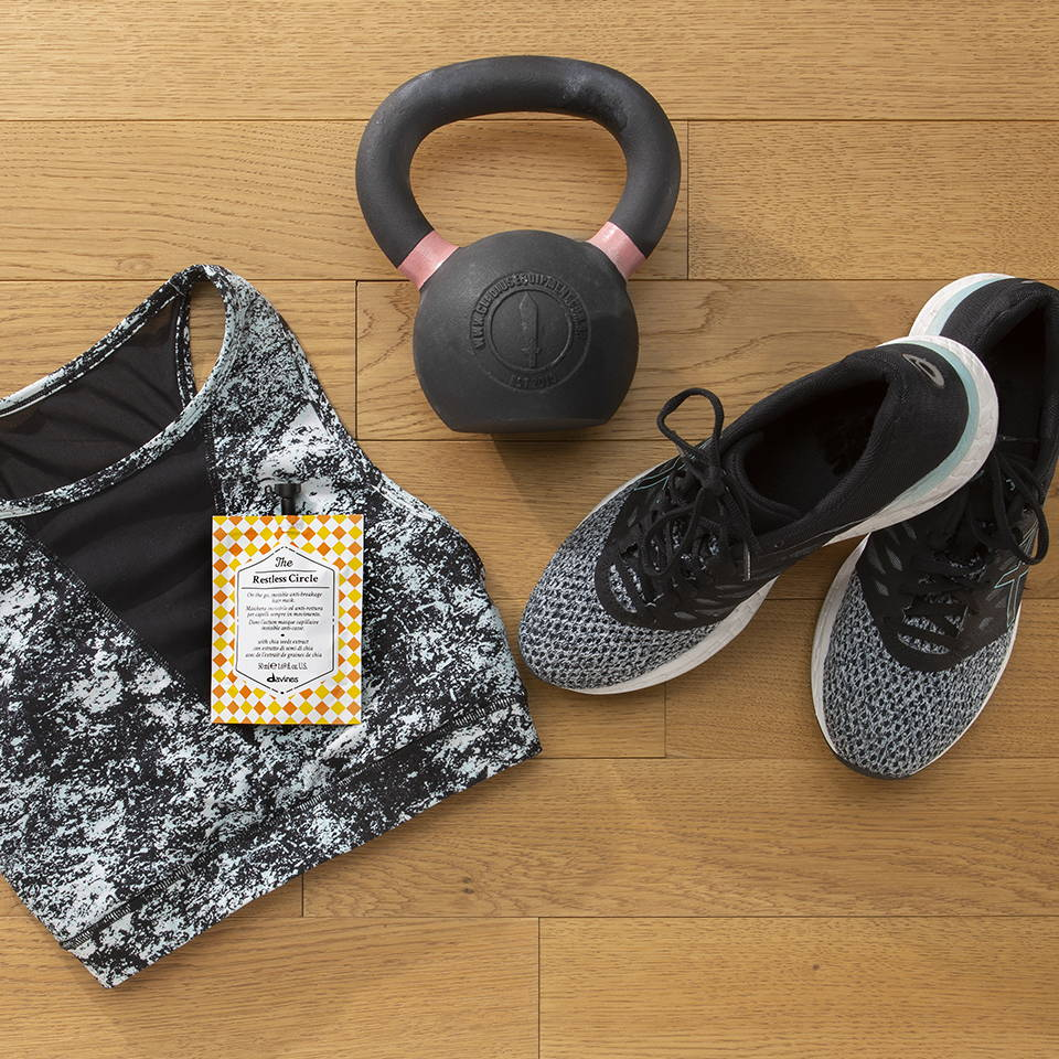A Davines hair mask pouch with a workout outfit