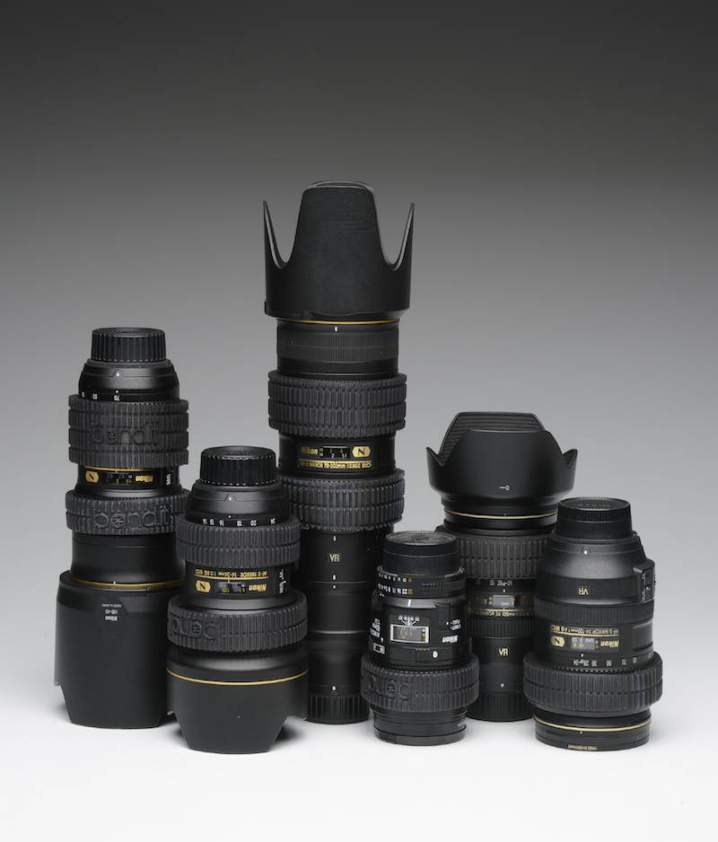 a collection of bandits that stop lens creep on nikon lenses