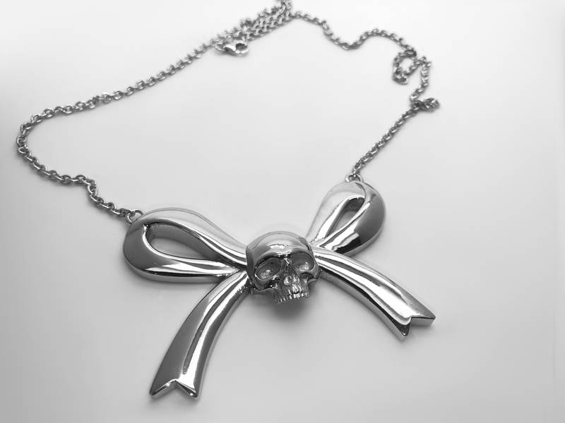 silver skull and cross pendant on ribbon