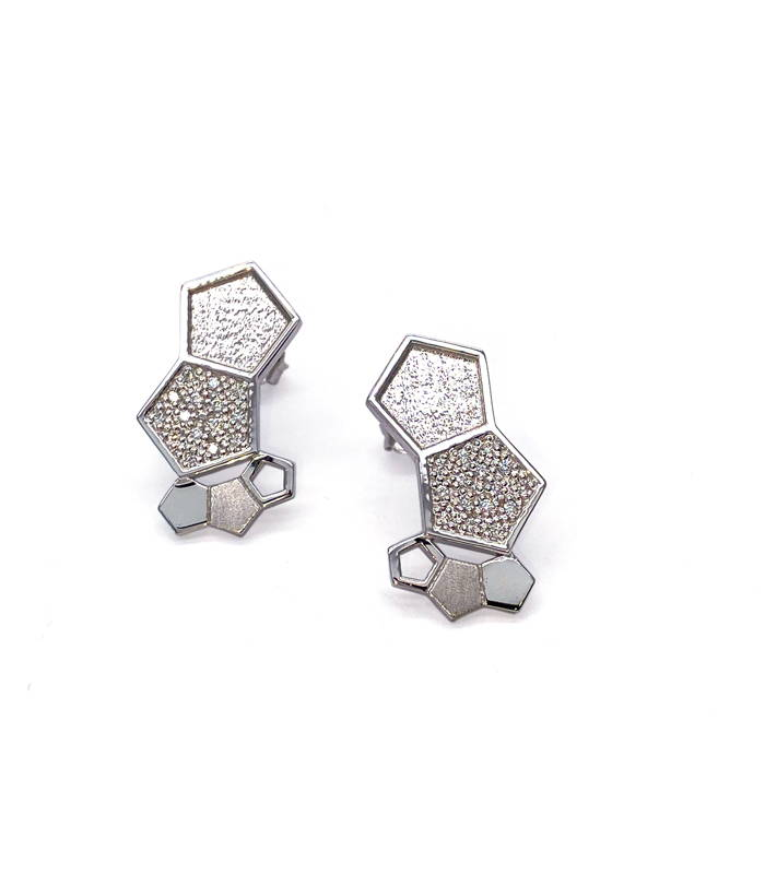 Earrings made of an arrangement of small textured hexagonal shapes of different sizes in white gold