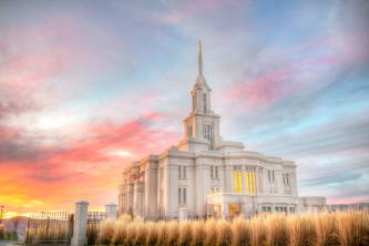 A pastel sky above the Payson Utah Temple and an autumn field.