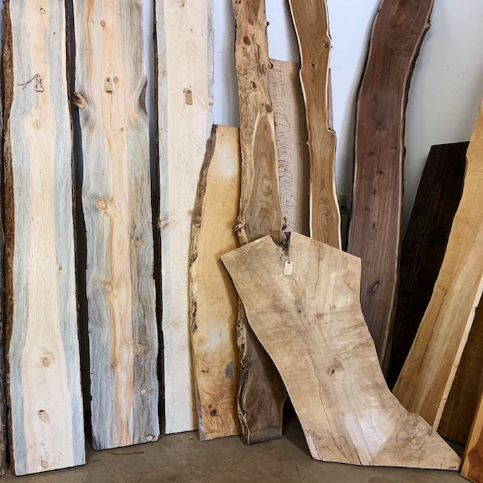 Reclaimed live edge slabs in showroom