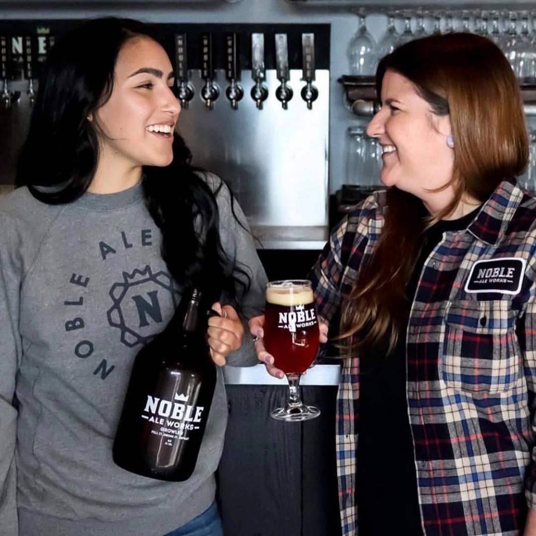 girls holding beer in custom apparel