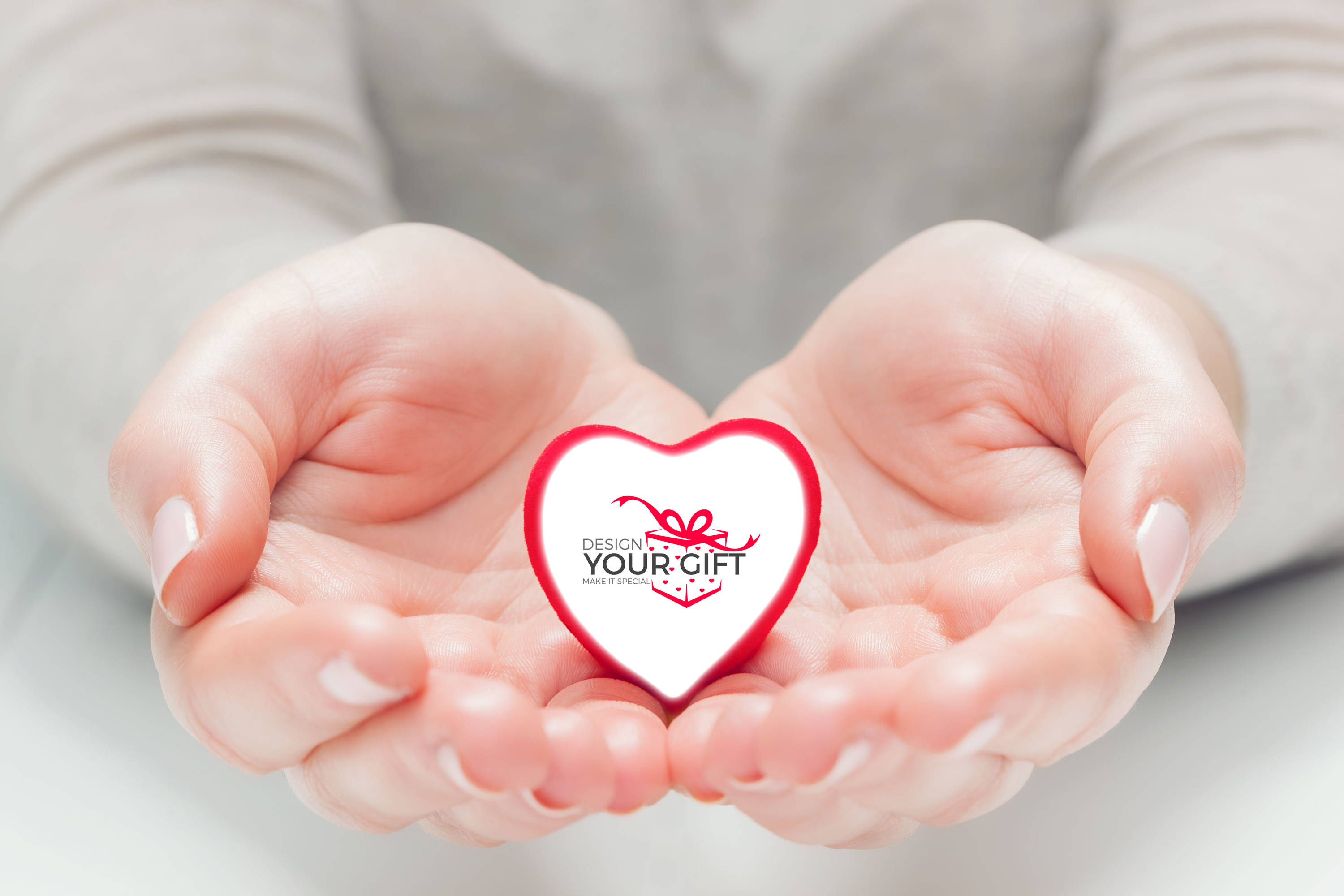 hands holding a heart with design your gift uk logo