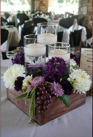 purple flower and candle center piece