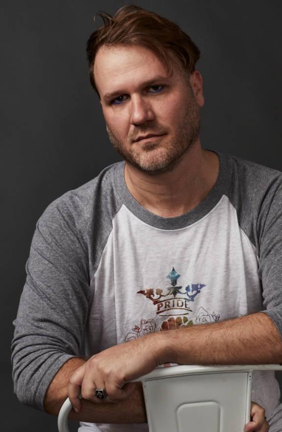 Male model wears LGBTQ Pride shirt.