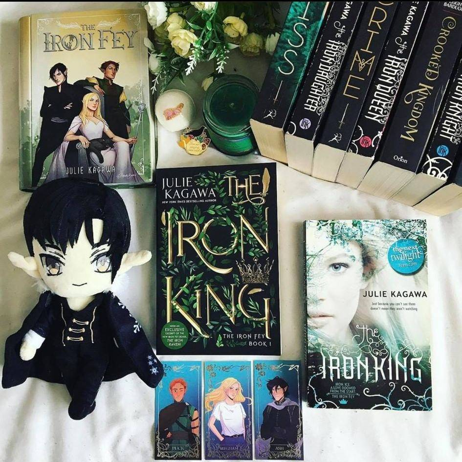 The Iron King Anniversary Edition by Julie Kagawa with Annoted Chapter Booklet and Signed Bookplate, Prince Ash Plushie, Witchwood Arrow Necklace, Otaku Faery Holographic Keychain, Iron Fey Book Tin, Puck Enamel Pin, and The Between Geode Bath Bomb