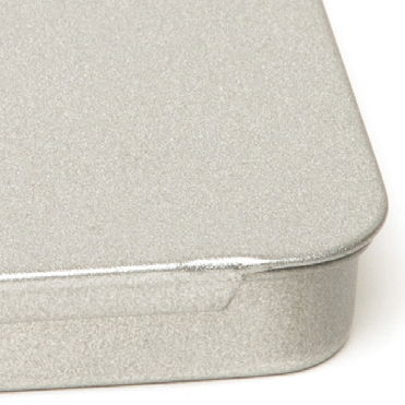 A tin with a silver glow finish